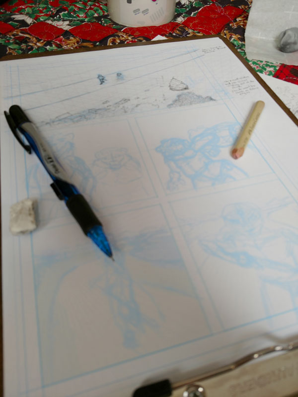 Photo of the printed layout sketch, with pencil work on the first panel partially complete.